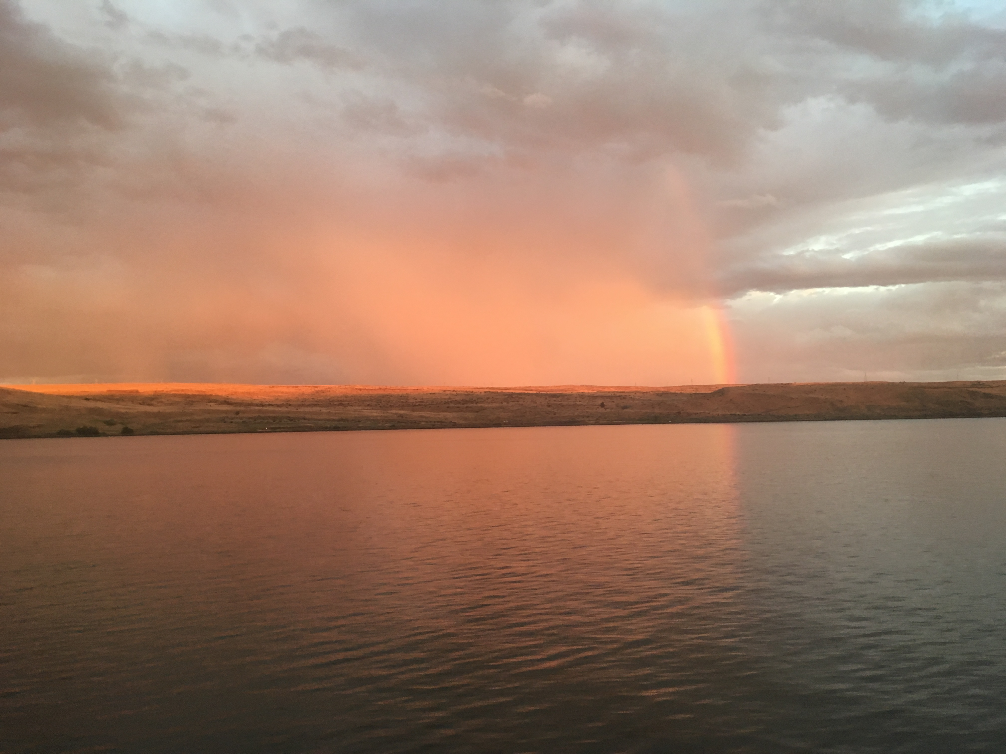 The Columbia River at sunset with rainbow.